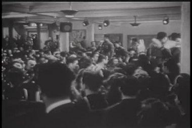 Wide shot of World War II servicemen celebrating — Stock Video