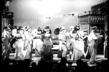 Actors in costumes dancing and singing on stage
