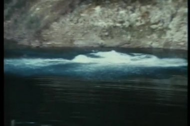 Three jumping off cliff into river — Stock Video