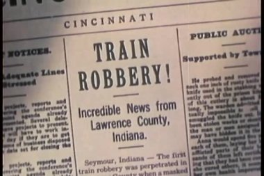 Montage of newspaper headlines of train robberies — Stock Video