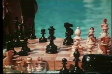 Medium shot of man and woman playing chess — Stock Video