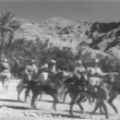 Moroccan cavalry charging through the desert — Stock Video
