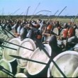Medieval soldiers shooting arrows at opposition on battlefield — Stock Video
