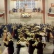 Stock Video: Wide shot of couples dancing at college event
