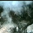 Bombs exploding around soldiers in cave — Wideo stockowe