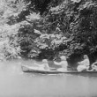Rowing down river on canoe — Stock Video