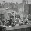 Wide shot conductor rehearsing band on rooftop — Stock Video