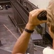 Stock Video: Mlooking through binoculars