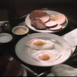 Stock Video: Close-up of hands reaching for envelope on breakfast tray