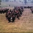 Medieval soldiers crossing field with dead body in tow — Wideo stockowe