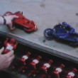 Man assembling toys on production line — Stock Video