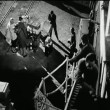 High angle view men loading luggage on ship — Stockvideo