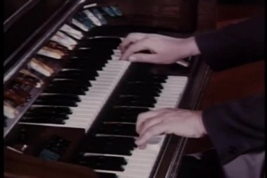 Close-up hands playing organ — Stock Video #26662811