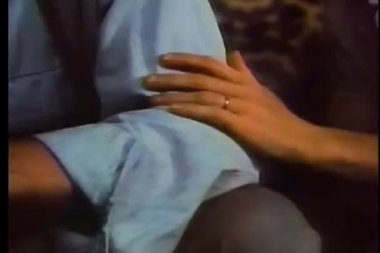 Close-up of woman's hand caressing man's arm — Stock Video