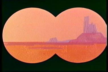 Binoculars panning barren landscape to cafe — Stock video