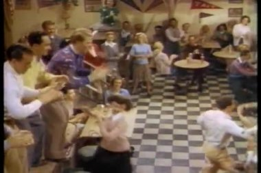 College students dancing in cafeteria — Stock Video