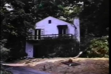 Establishing shot of house in the woods — Stock Video