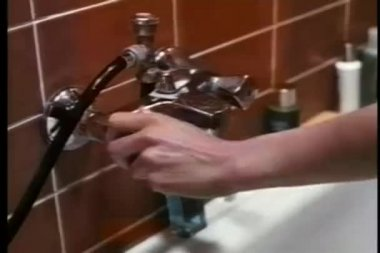 Close-up woman turning on water for bath — Stock Video