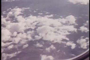 View of clouds from airplane window — Stock Video #26663537