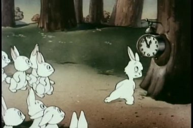 Rabbits in forest waiting for clock to strike one — Stock Video