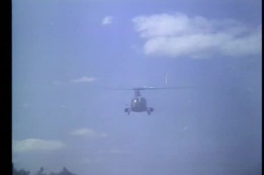 Helicopter firing missile into grove — Stock Video