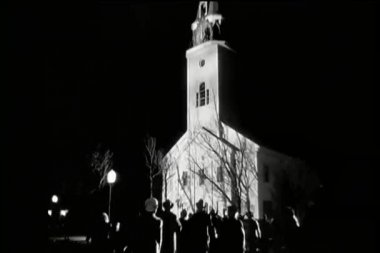 Rear view crowd rushing to church at night — Stock Video