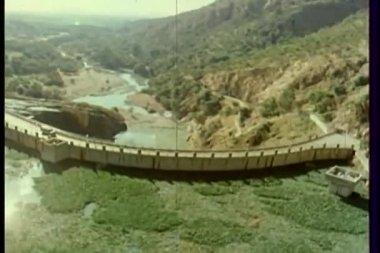 Aerial view of bridge across mountain — Stock Video