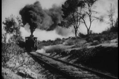 Locomotive coming down railroad track — Stock Video