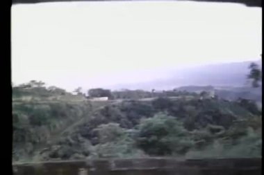 View from car window of mountainous countryside — Stock Video