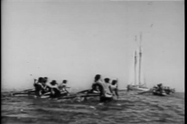 Rear view natives in canoes paddling towards boat at sea — Stock Video