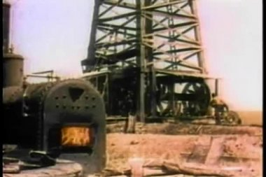 Wide shot furnace and derrick at oil refinery — Stock Video