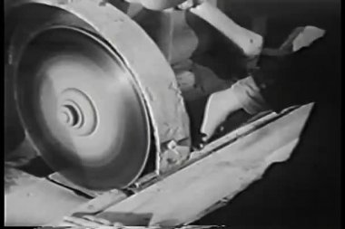 Medium shot of hands working on wood cutting machine — Stock Video