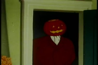 Man with pumpkin head standing in doorway — Stock Video