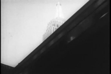 View of Empire State Building from below elevated train — Stock Video #26664153