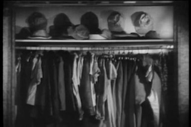 Opened closet with 1940s clothes, shoes and hats — Stock Video
