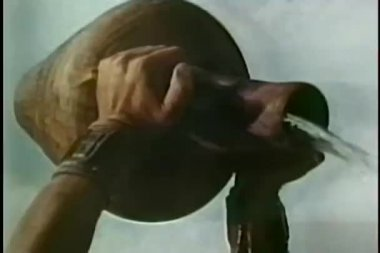 Close-up of hands pouring water from jug — Stock Video