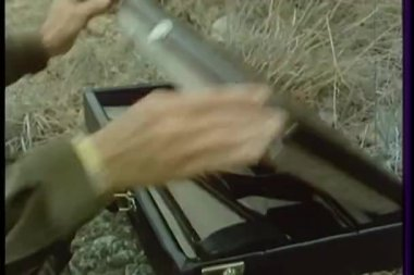 Man opening up gun case to assemble rifle — Stock Video