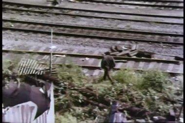 High angle view man crossing railroad tracks — Stock Video #26664289