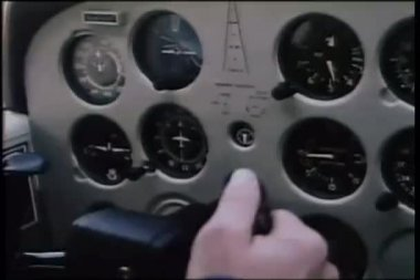 Close-up pilot pushing throttle in cockpit of airplane