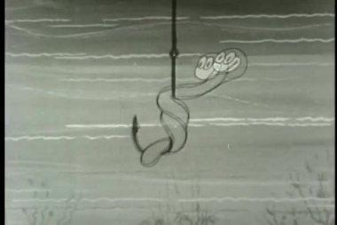 Worm on fishing hook with binoculars — Stock Video