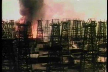 Long shot oil refinery fire speading towards oil storage tanks — Stock Video