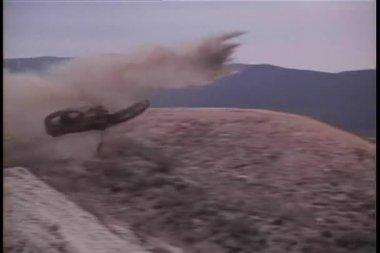 Motorcycle flying off road followed by biker — Stock Video