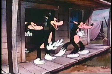 Cartoon of three amused wolves on porch — Stock Video