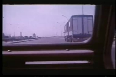View out of moving car while passing an 18 wheeler — Stock Video