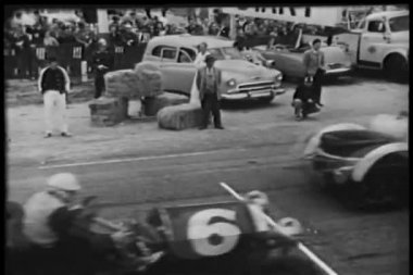 Spectators watching car race — Stock Video #26664727