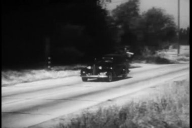 1940s car driving on country road — Stock Video