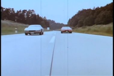 Two cars racing on empty road — Video Stock