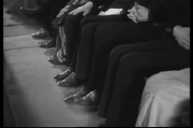 Row of stamping their feet in time to the music — Stock Video