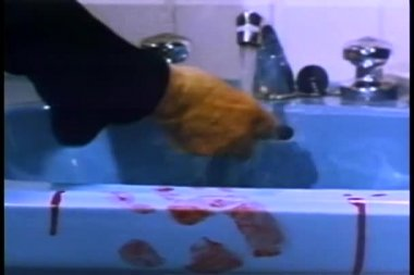 Close-up of hand cleaning blood stained sink with sponge — Stock Video