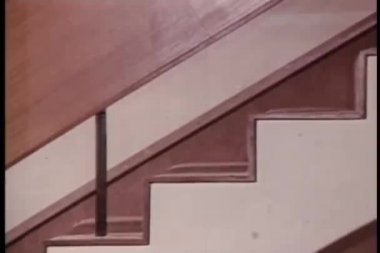 Close-up woman's legs as she walks down staircase — 图库视频影像